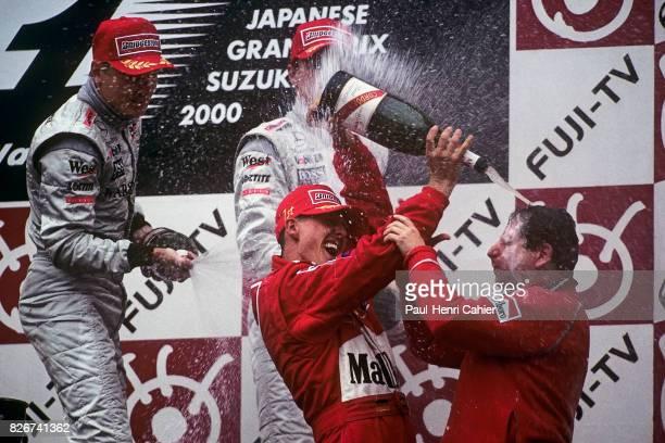 Michael Schumacher, Jean Todt, Mika Hakkinen, Grand Prix of Japan, Suzuka, 08 October 2000. Champagne shower for Ferrari Team Manager Jean Todt.