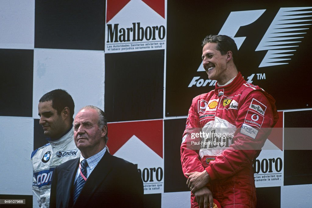 Michael Schumacher, Juan Carlos King of Spain, Juan Pablo Montoya, Grand Prix of Spain, Circuit de Barcelona-Catalunya, 28 April 2002. Michael Schumacher sharing the winners podium with Juan Carlos King of Spain.