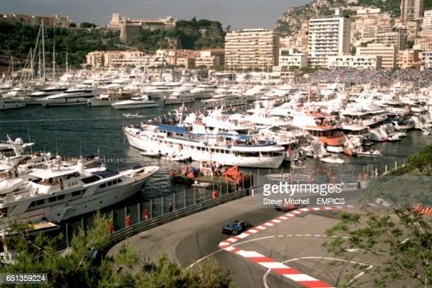 Michael Schumacher leads Kimi Raikkonen past the Monte Carlo marina