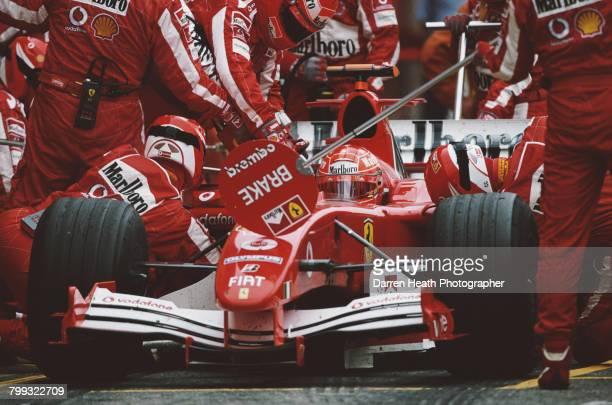 Michael Schumacher of Germany aboard the Scuderia Ferrari Marlboro Ferrari F2005 F1 Ferrari V10 makes a pit stop during the Formula One San Marino...
