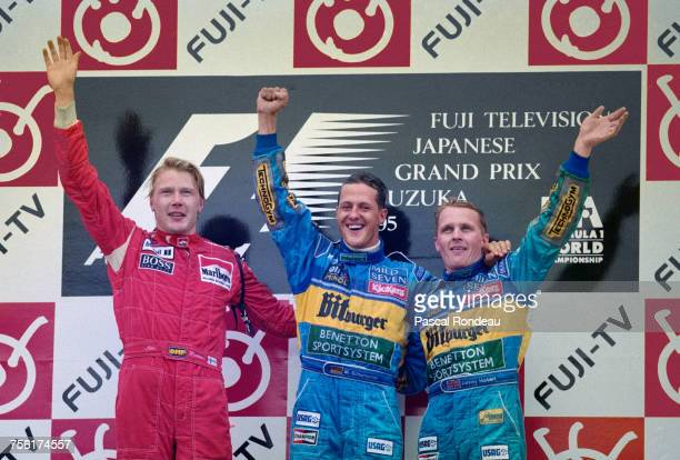 Michael Schumacher of Germany and driver of the Mild Seven Benetton Renault Benetton B195Renault RS7 V10 celebrates with third placed team mate...
