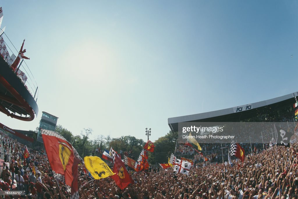 Michael Schumacher of Germany and driver of the #5 Scuderia Ferrari Marlboro Ferrari 248 F1 Ferrari V8 salutes the flag waving Tifosi fans after winning his 90th Grand Prix at the Formula One Italian Grand Prix on 10 September 2006 at the Autodromo Nazionale Monza, Monza, Italy.