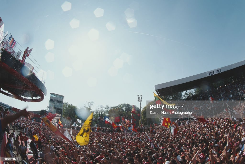 Michael Schumacher of Germany and driver of the #5 Scuderia Ferrari Marlboro Ferrari 248 F1 Ferrari V8 salutes the flag wavingTifosi fans after winning his 90th Grand Prix at the Formula One Italian Grand Prix on 10 September 2006 at the Autodromo Nazionale Monza, Monza, Italy.