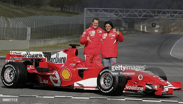 Michael Schumacher of Germany and Felipe Massa of Brazil pose with the Ferrari 248 F1 during the launch of the new Ferrari F1 car for the Season 2006...