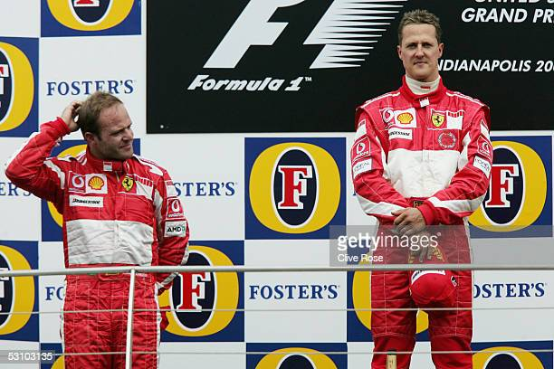 Michael Schumacher of Germany and Ferrari and Rubens Barrichello on the podium after the United States F1 Grand Prix at the Indianapolis Motor...