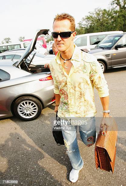 Michael Schumacher of Germany and Ferrari arrives at the paddock during the previews for the Italian Formula One Grand Prix at Autodromo Nazional...