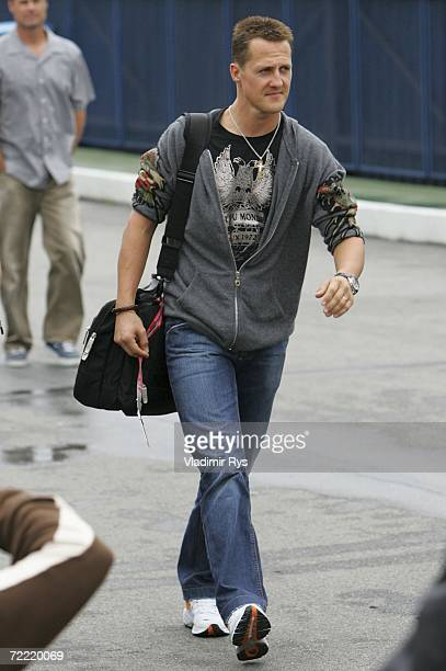 Michael Schumacher of Germany and Ferrari arrives at the paddock during the previews for the Brazilian Formula One Grand Prix at Interlagos Circuit...