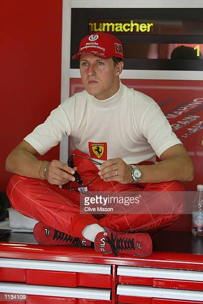 Michael Schumacher of Germany and Ferrari awaits the start of first practice for the Formula One French Grand Prix at Nevers MagnyCours Circuit France