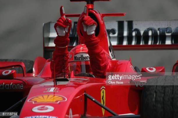 Michael Schumacher of Germany and Ferrari celebrates after winning the German F1 Grand Prix at the Hockenheim Circuit on July 25 in Hockenheim,...