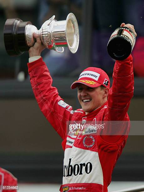 Michael Schumacher of Germany and Ferrari celebrates after winning the World Championship after coming third in the Belgium F1 Grand Prix at the...