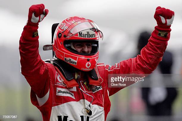 Michael Schumacher of Germany and Ferrari celebrates after winning the Formula One Chinese Grand Prix at Shanghai International Circuit on October 1...
