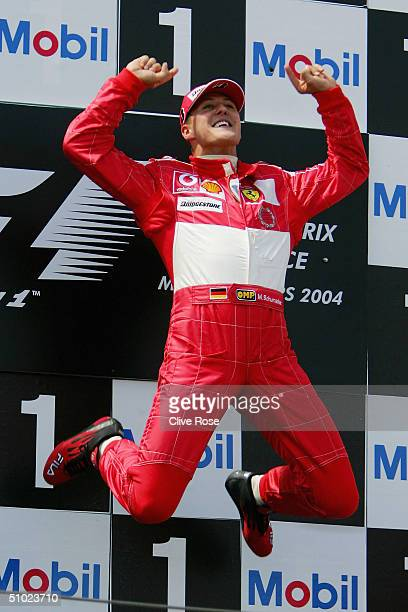 Michael Schumacher of Germany and Ferrari celebrates on the podium after winning the French F1 Grand Prix at the MagnyCours Circuit on July 4 in...