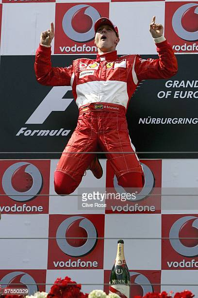 Michael Schumacher of Germany and Ferrari celebrates on the podium after winning the European F1 Grand Prix at the Nurburgring on May 7 in Nurburg,...