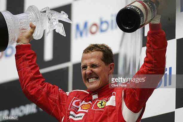 Michael Schumacher of Germany and Ferrari celebrates on the podium after winning the German Formula One Grand Prix at the Hockenheimring on July 30...