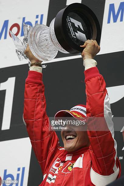 Michael Schumacher of Germany and Ferrari celebrates on the podium after winning the German Formula One Grand Prix at the Hockenheimring on July 30,...