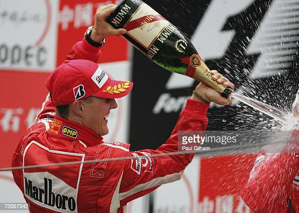 Michael Schumacher of Germany and Ferrari celebrates on the podium after winning the Chinese Formula One Grand Prix at Shanghai International Circuit...