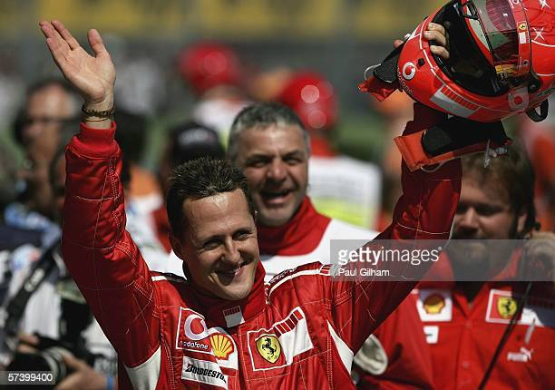Michael Schumacher of Germany and Ferrari celebrates securing pole position during the qualifying session for the San Marino Formula One Grand Prix...