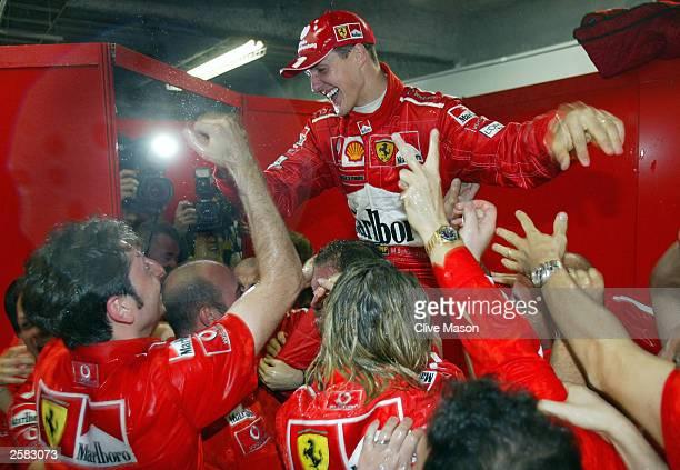 Michael Schumacher of Germany and Ferrari celebrates winning his 6th World Championship during the Formula One Japanese Grand Prix in Suzuka on...