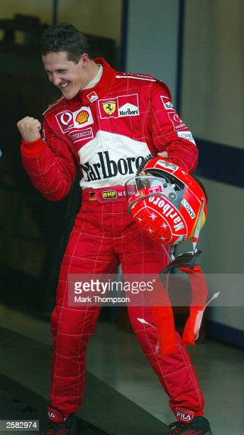Michael Schumacher of Germany and Ferrari celebrates winning record a 6th world championship during the Formula One Japanese Grand Prix in Suzuka on...