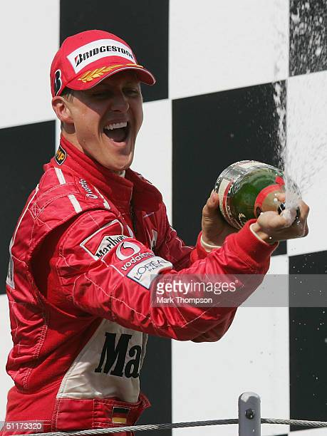 Michael Schumacher of Germany and Ferrari celebrates winning the Hungarian F1 Grand Prix at the Hungaroring Circuit on August 15 in Budapest,...