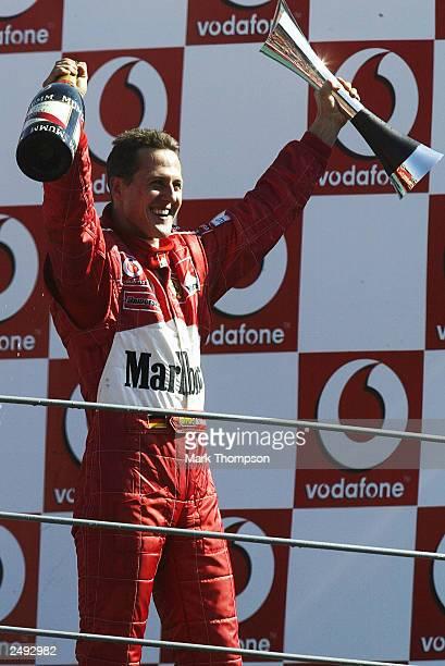 Michael Schumacher of Germany and Ferrari celebrates winning the FIA Formula One Italian Grand Prix at the Autodromo Nazionale Monza on September 1...