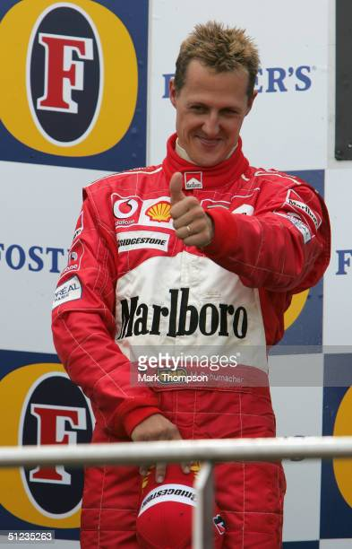Michael Schumacher of Germany and Ferrari celebrates winning the Driver's Championship after he finished second in the Belgium F1 Grand Prix at the...