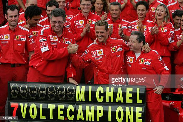 Michael Schumacher of Germany and Ferrari celebrates winning the World Drivers Championship at the Belgium F1 Grand Prix at the Circuit of Spa...