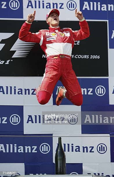 Michael Schumacher of Germany and Ferrari celebrates winning the French Formula One Grand Prix at the Nevers Magny-Cours Circuit on July 16 in...