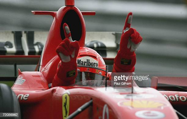 Michael Schumacher of Germany and Ferrari celebrates winning the Chinese Formula One Grand Prix at Shanghai International Circuit on October 1 2006...