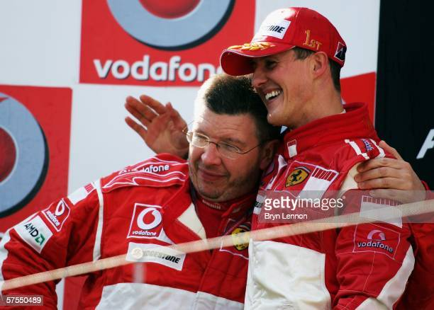 Michael Schumacher of Germany and Ferrari celebrates with Ferrari Technical Director Ross Brawn after winning the European F1 Grand Prix at the...