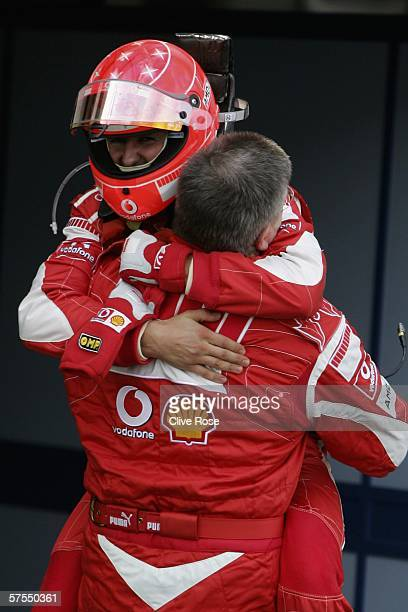 Michael Schumacher of Germany and Ferrari celebrates with Ross Brawn in parc ferme after winning the European F1 Grand Prix at the Nurburgring on May...