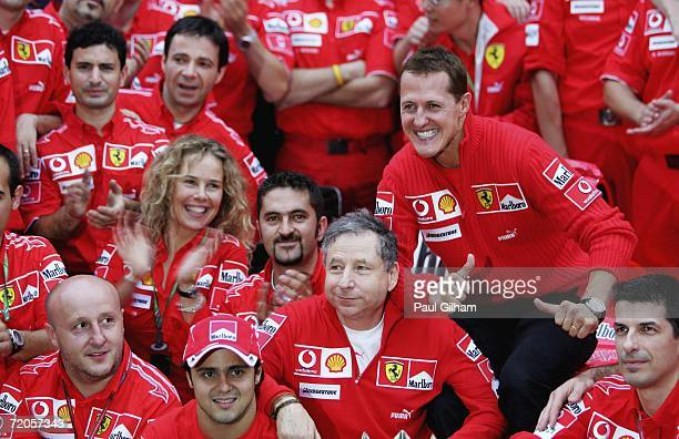 Michael Schumacher of Germany and Ferrari celebrates with Team Principal Jean Todt and his teammates after winning the Chinese Formula One Grand Prix...