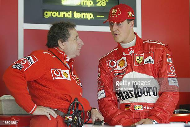 Michael Schumacher of Germany and Ferrari chats to Ferrari Technical Director Jean Todt during a delayed start to first practice for the FIA Formula...
