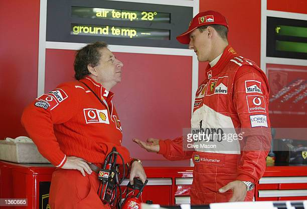 Michael Schumacher of Germany and Ferrari chats to Ferrari Technical Director Jean Todt during first practice for the FIA Formula One Belgian Grand...