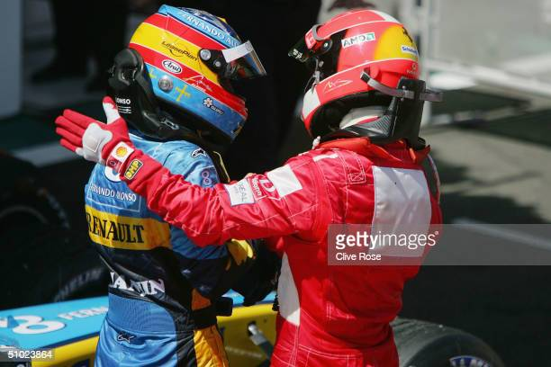 Michael Schumacher of Germany and Ferrari congratulates Fernando Alonso after the French F1 Grand Prix at the MagnyCours Circuit on July 4 in...