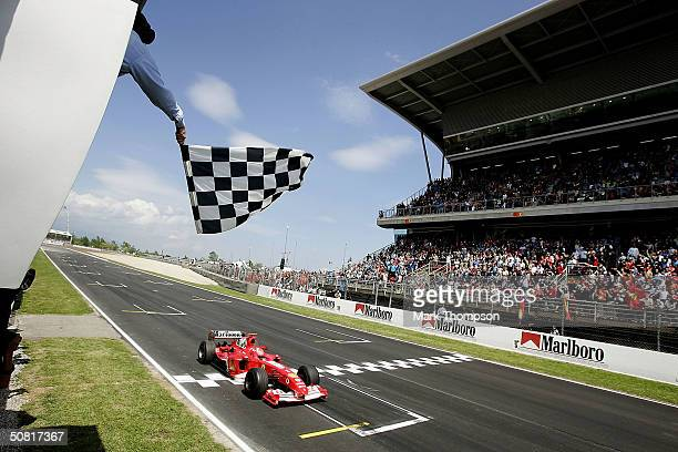 Michael Schumacher of Germany and Ferrari crosses the finish line to win the Spanish F1 Grand Prix on May 9 at the Circuit de Catalunya in Barcelona,...