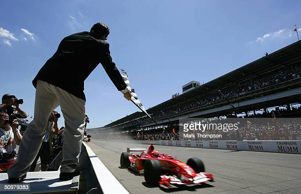 Michael Schumacher of Germany and Ferrari crosses the finish line to win the United States F1 Grand Prix at the Indianapolis Motor Speedway Circuit...