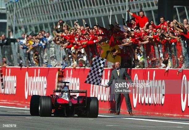 Michael Schumacher of Germany and Ferrari crosses the line to win the FIA Formula One Italian Grand Prix at the Autodromo Nazionale Monza on...