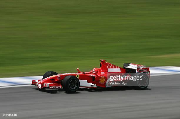 Michael Schumacher of Germany and Ferrari drives during the practice round before the qualifying session of the Brazilian Formula One Grand Prix at...
