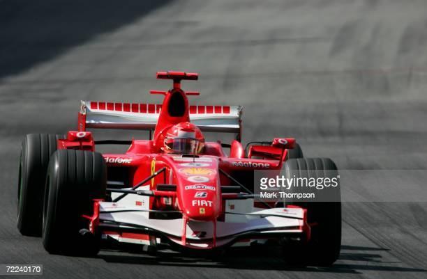 Michael Schumacher of Germany and Ferrari drives in the Brazilian Formula One Grand Prix at the Autodromo Interlagos on October 22, 2006 in Sao...