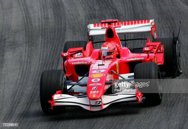 Michael Schumacher of Germany and Ferrari drives with a puncture in the Brazilian Formula One Grand Prix at the Autodromo Interlagos on October 22,...