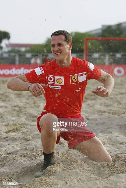 Michael Schumacher of Germany and Ferrari in action during a beach football match during the previews to the Spanish Formula One Grand Prix at the...