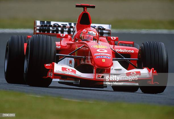 Michael Schumacher of Germany and Ferrari in action during the Formula One Japanese Grand Prix on October 12 2003 in Suzuka Japan