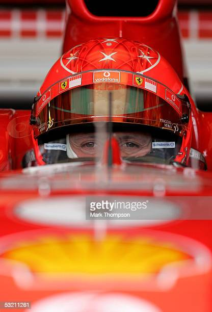 Michael Schumacher of Germany and Ferrari in his cockpit during the practice session for the British F1 Grand Prix at Silverstone Circuit on July 8...