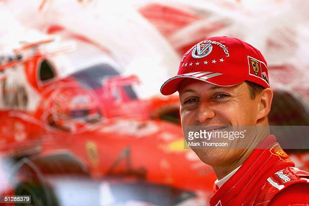 Michael Schumacher of Germany and Ferrari in the team garage during the practice session prior to qualifying for the Italian F1 Grand Prix at the...