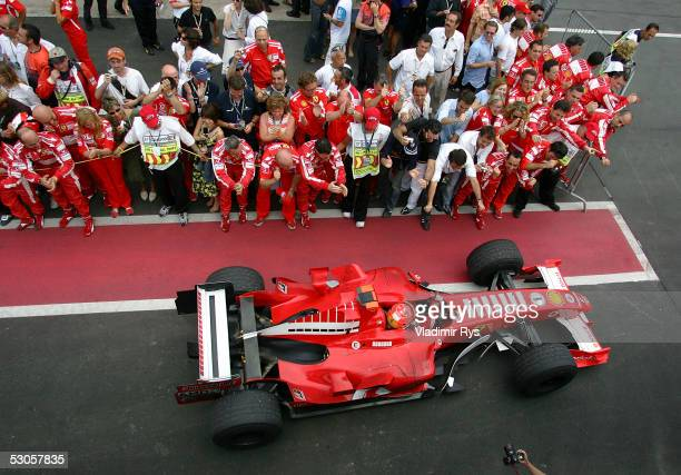Michael Schumacher of Germany and Ferrari is beein celebrated from his team members on the pit lane after the Canadian F1 Grand Prix on June 12 2005...