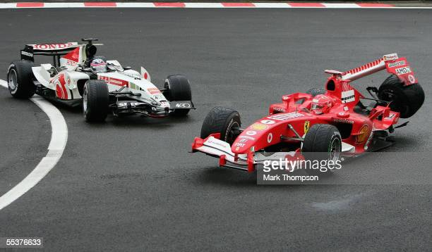 SPA FRANCORCHAMPS BELGIUM SEPTEMBER 11 Michael Schumacher of Germany and Ferrari is involved in a collision with Takuma Sato of Japan and BAR during...