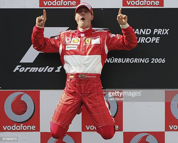Michael Schumacher of Germany and Ferrari jumps on the podium after winning the F1 Grand prix of Europe at the Nurburgring on May 7 in Nurburg,...