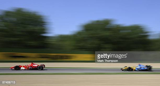 Michael Schumacher of Germany and Ferrari lead Fernando Alonso of Spain and Renault during the San Marino Formula One Grand Prix at the San Marino...