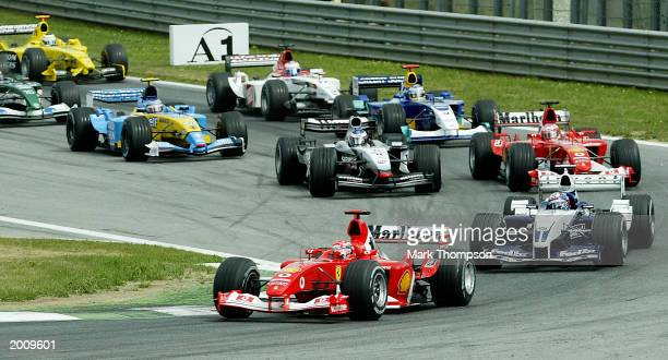 Michael Schumacher of Germany and Ferrari leads at the first corner during the Austrian Grand Prix on May 18, 2003 at the A1 Ring in Spielberg,...